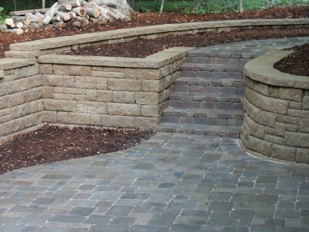 Retaining Walls | Stone Creek Hardscapes & Designs on home backyard ideas, brick paver fire pit, brick retaining wall backyard ideas, brick paver landscaping, flagstone backyard ideas, used brick backyard ideas, masonry backyard ideas, concrete backyard ideas,