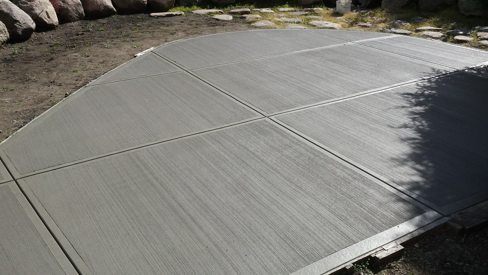 Concrete Driveways by Stone Creek Hardscapes & Design